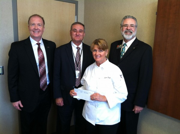 Dave Knowles presents a check on behalf of LEAN Frog to Ms. Susan Steele (Director, Culinary Arts, Stewarts Creek High School) as Dr. Clark Harrell (Principal, Stewarts Creek High School) and Mr. Don Odom (Director of Schools, Rutherford County Schools) look on.