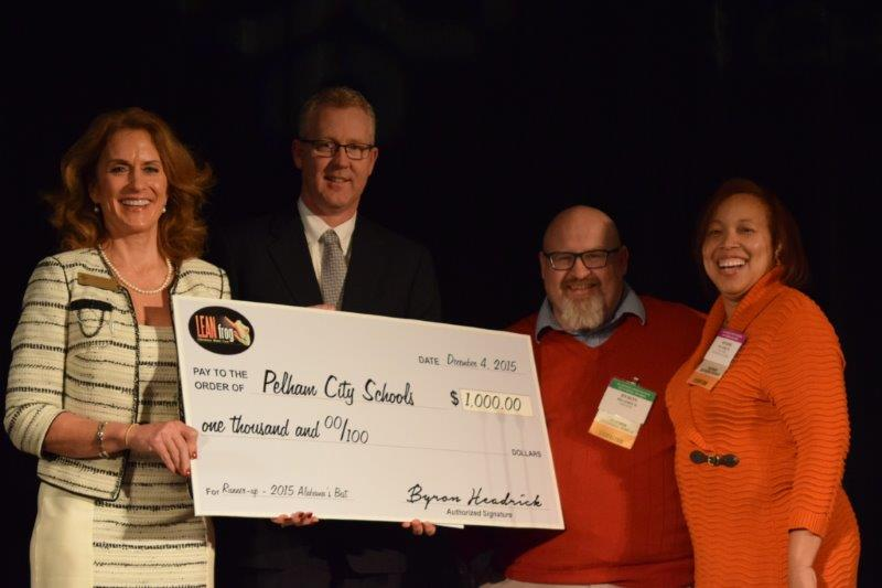 Superintendent Dr. Scott Coefield accepts runner up $1000 prize for Pelham City Schools