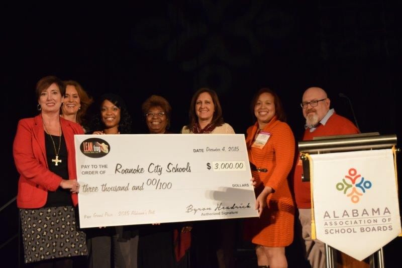 Assistant Superintendent Dr. Kim Hendon and board members Lisa Reed, Lynn Houston and Mary Ann Jordan accept the $3000 Grand Prize for Roanoke City Schools