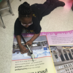 2)A Lauderdale County student practices the skills learned during whole group and/or reduced group instruction.