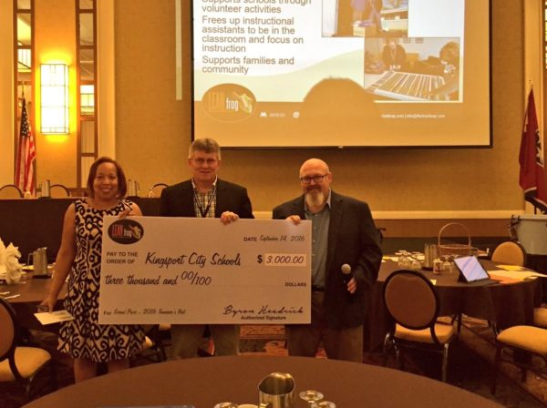 Superintendent Lyle Ailshie accept the $3,000 cash prize from LEAN Frog Co-founders Byron and Sherri Headrick